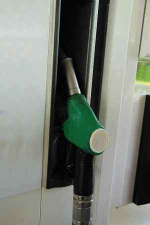 self service: Pumping gas at a self service gas station Stock Photo