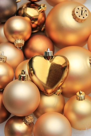 Pile of christmas ornaments in different sizes and shades of gold photo