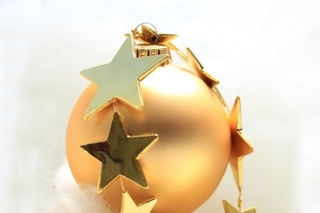 Golden christmas ornament and stars photo