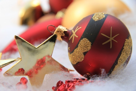 Christmas decorations in red and gold: ornament and star photo