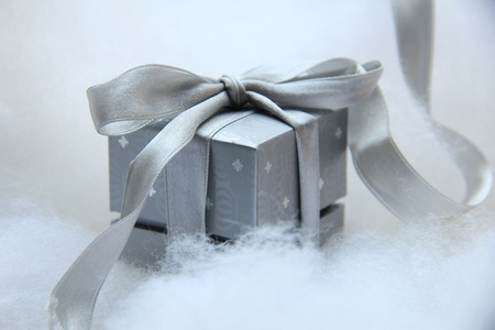 Luxury christmas gift in a silver box with a grey silver satin ribbon photo