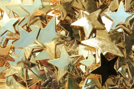 Small golden stars in various sizes, christmas garland photo