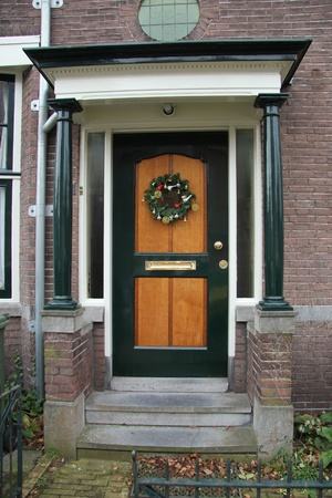 Entrace of a house, decorated for the holidays photo