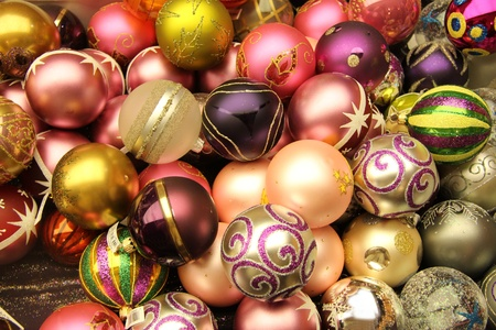 Pile of glass, handpainted christmas ornaments in various colors photo