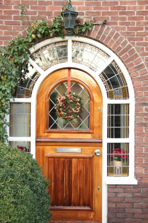 Stained glass window with christmas wreath photo