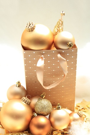 Group of golden christmas decorations in various shapes in a gift bag photo