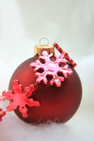 Red christmas decorations: ice crystal on a ball photo