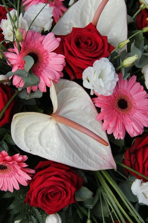 Anthurium, roses and gerberas in red, pink and white in a bridal flower arrangement photo