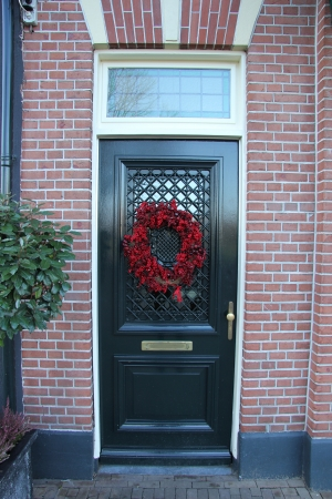 Wreath made of berries on a classic front door photo