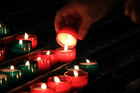 Red and green votive candles in a French church photo