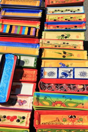 Colorful pottery with traditional Provencal patterns at a market in the Provence, France photo