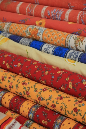 Textile on rolls, traditional colors and patterns from the Provence, France photo