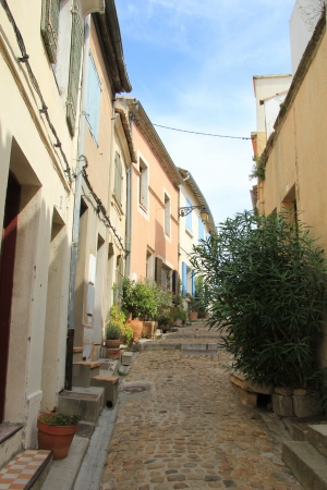Street with old houses in Arles, Provence photo