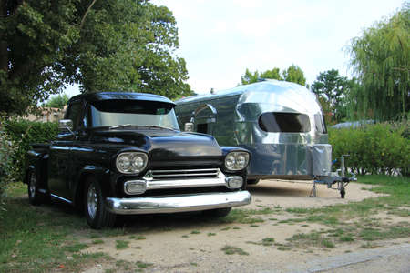 fourwheeldrive: Vintage car and caravan at a camping site Stock Photo