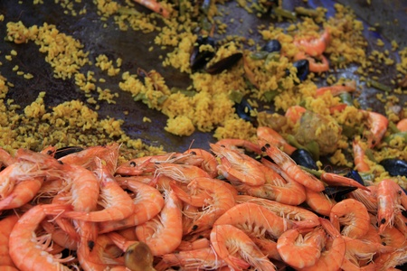 paella: saffron rice, chicken, meat and seafood photo