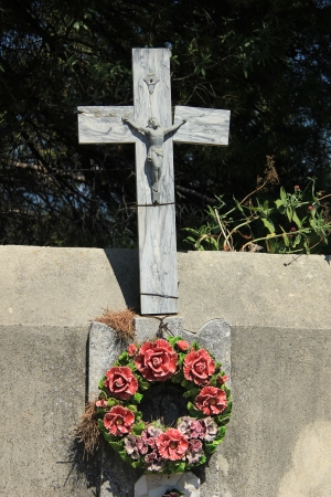 mortality: Funeral wreath with ceramic flowers at a French cemetery