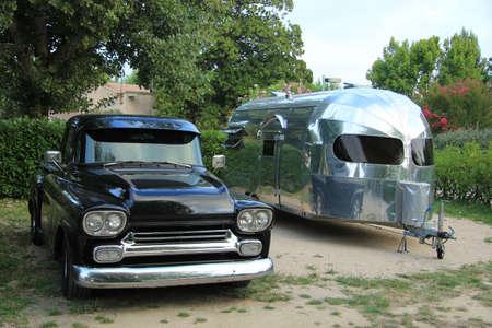 airstream: Vintage car and caravan at a camping site Stock Photo