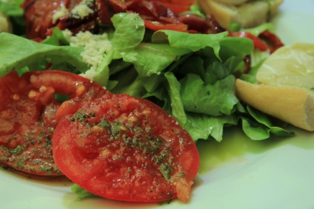 crudite: Goat cheese tomato salad with condiments, close up
