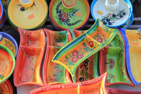 Pottery in traditional Provencal colors and patterns at a market in the Provence photo