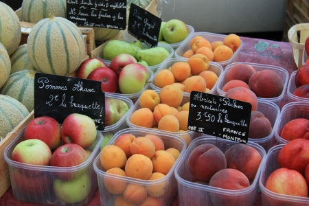 Different sorts of fruit at a market in France photo