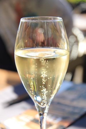 Glass of sparkling champagne at a wedding reception photo