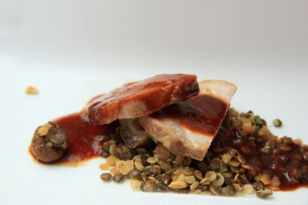 Pork on fried lentils, gourmet dish in fancy restaurant photo