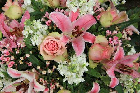 lillies: Pink lillies and roses in a pink and white wedding flower arrangement