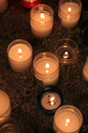 Votive candles, burning in a French Roman Catholic church photo