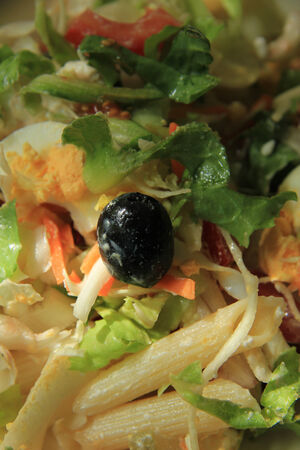Pasta salad with egg, tomato and lettuce photo