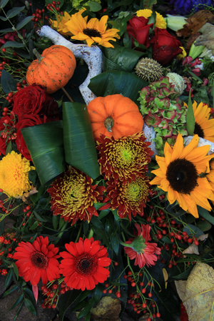 Flower arrangement for Thanksgiving in autumn colors photo