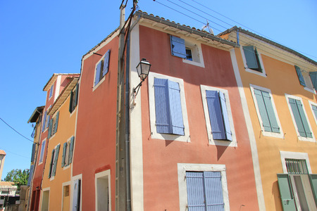 Traditional Provencal houses with plastered facades in bright colors in LIsle sur la Sorgue, France photo