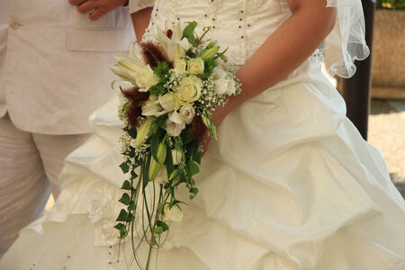 Bride with waterfall bridal bouquet photo