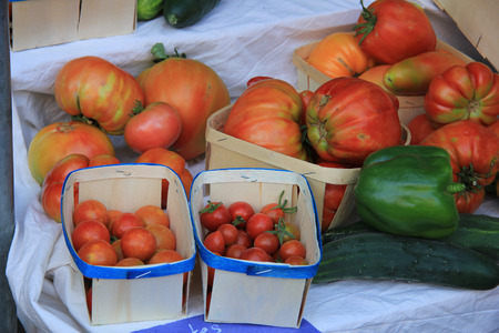 Different sorts of tomatoes at a market in France photo