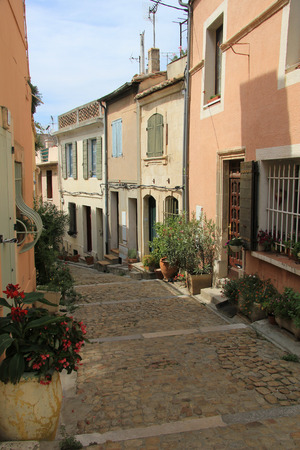 Street with old houses in Arles, Provence