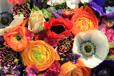 Spring bouquet with ranunculus and anemones in bright colors photo