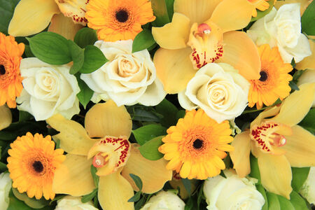 Cymbidium orchids, gerberas and roses in yellow and white in a bridal bouquet photo
