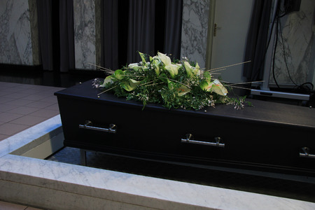 crematorium: Funeral flowers on a casket, funeral service