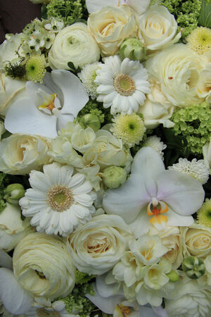 Mixed white wedding flowers, roses and phalaenopsis orchids photo
