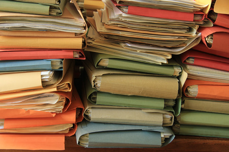 Stacked office files: pile of paperwork in an office photo