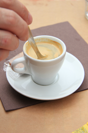 stiring: Man stiring an espresso Stock Photo