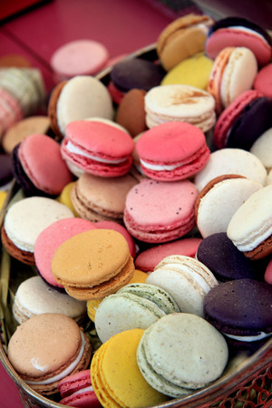 Macarons in different colors and flavours on a silver tray photo