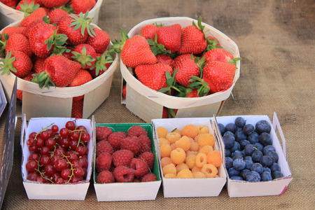 Strawberries, redcurrants and raspberries at a local French market photo