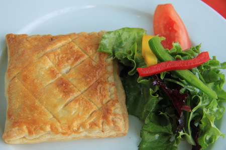 nutricion: Goat cheese in puff pastry with lettuce, French appetizer Stock Photo