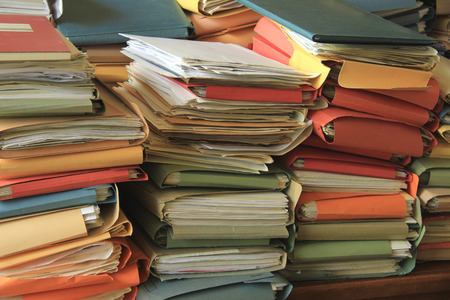 Stacked office files: pile of paperwork in an office