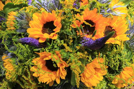 Blue and yellow wedding flowers: sunflowers and eryngium or\ sea holly