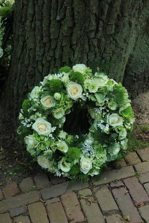 Sympathy wreath near a tree