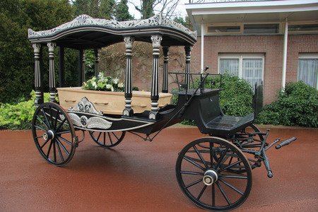 Classic funeral carriage with coffin photo