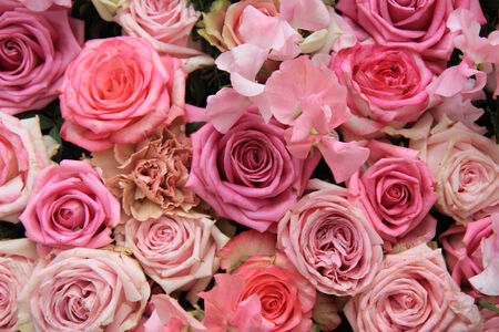 wedding flowers: Lathyrus and roses in a pink wedding arrangement