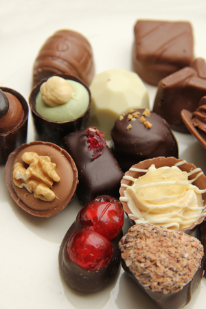 Luxury belgium chocolate pralines, decorated with fruits and nuts photo