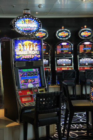 Slot machines in different sizes in a casino play room